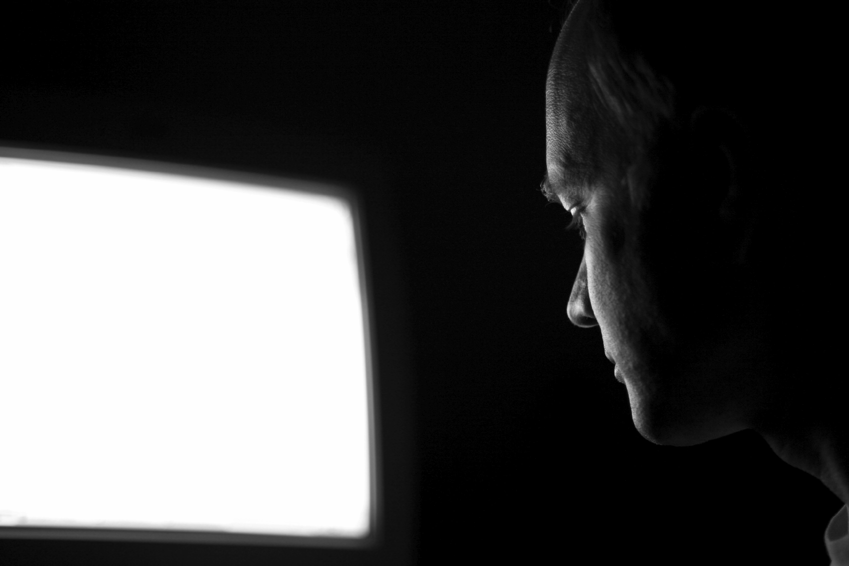 software engineer works at night, selective focus on face