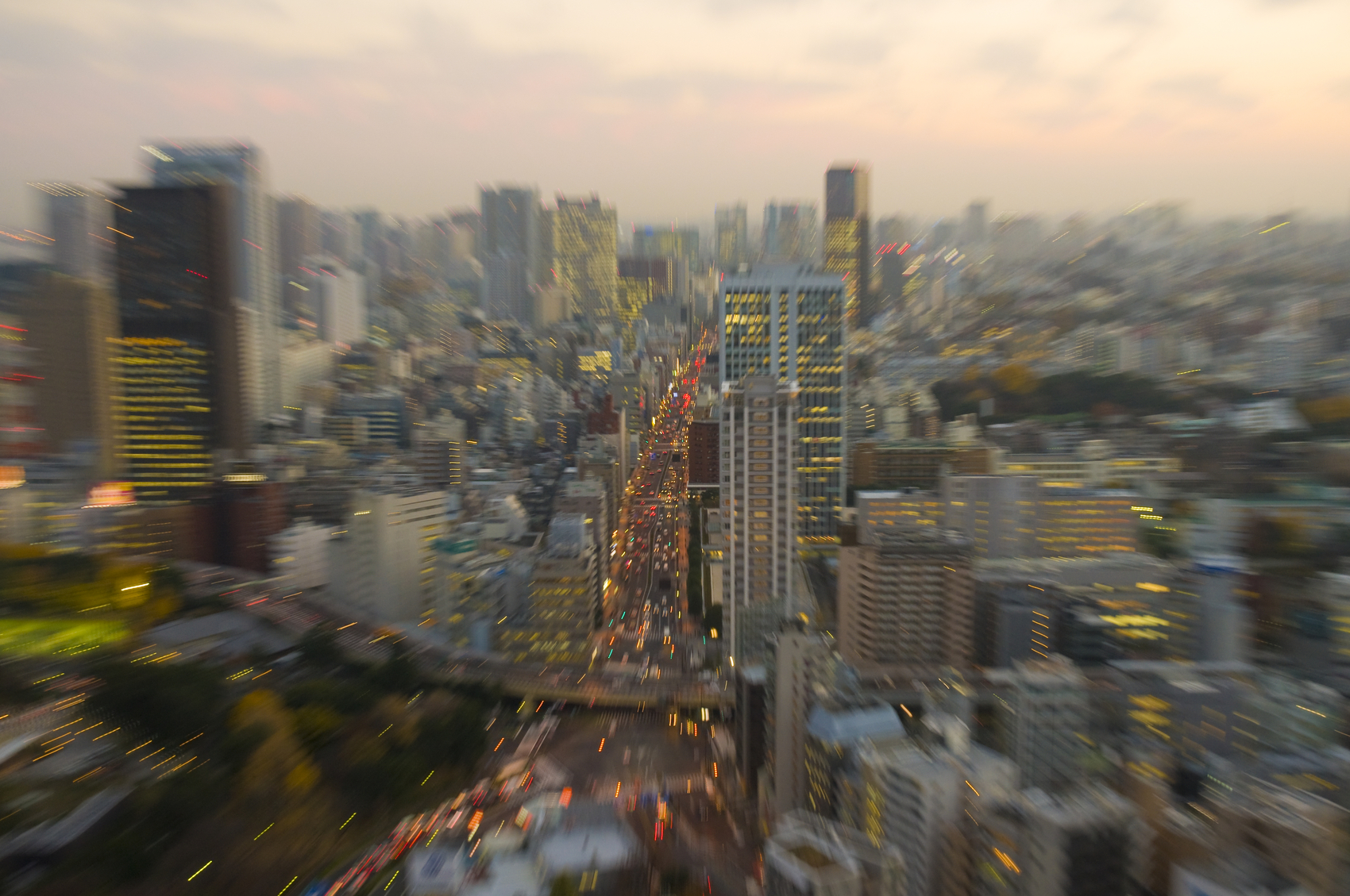 View from the Tokyo tower at sunset with zoom effect.Tokyo skyline.May be used to illustrate an earthquake.Please check more images here: