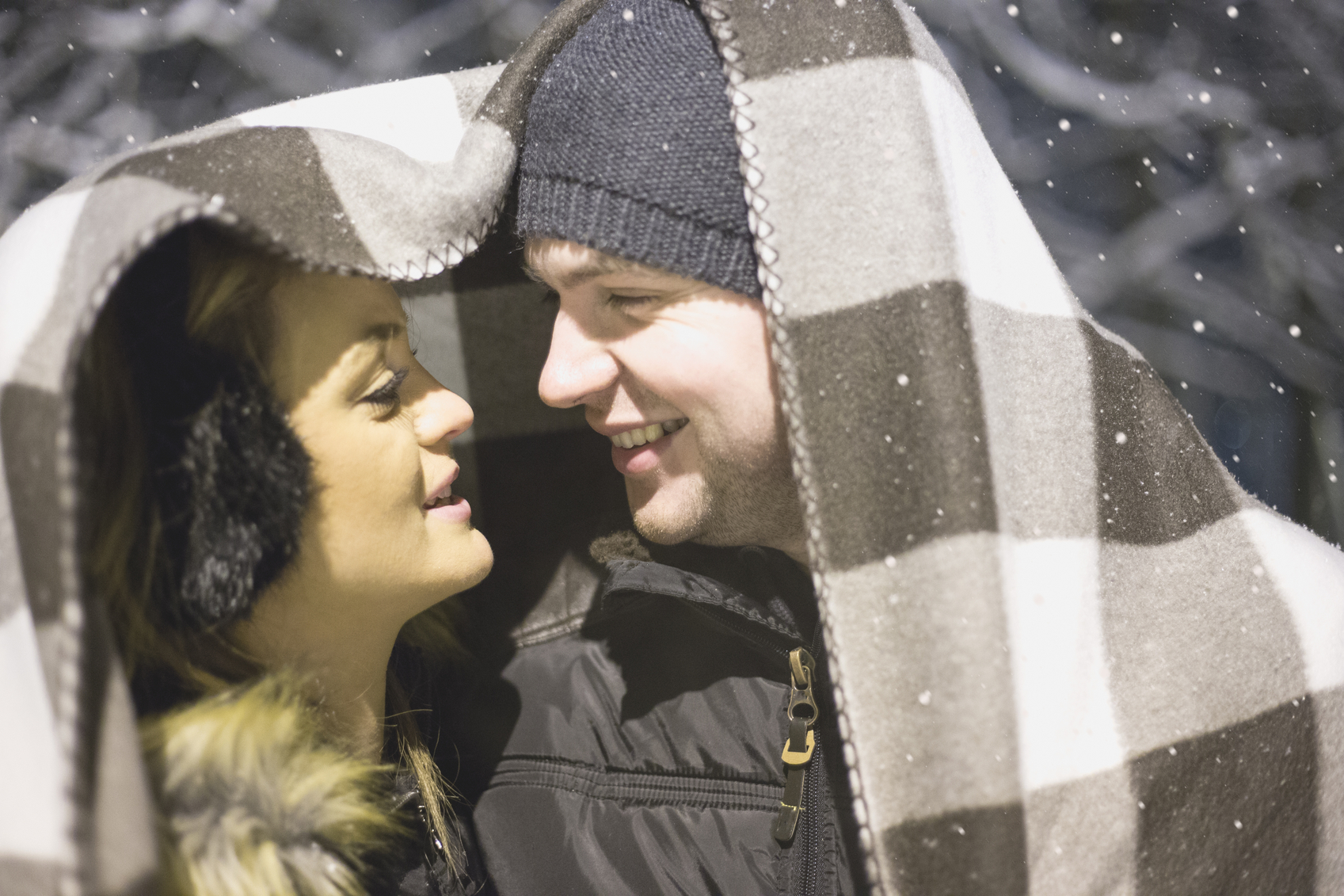Loving couple kissing on a snowy winter night